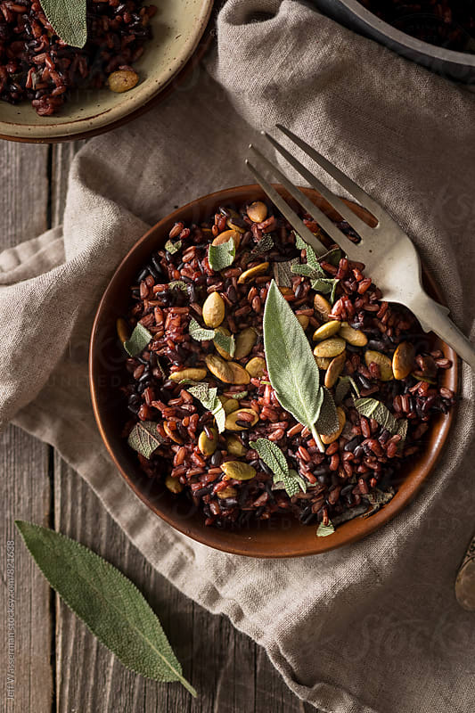 Heirloom Black and Red Rice with Pumpkin Seeds and Sage by Jeff Wasserman for Stocksy United