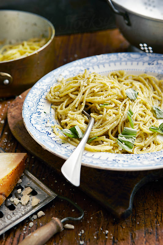 A bowl of pasta and pesto by James Ross for Stocksy United