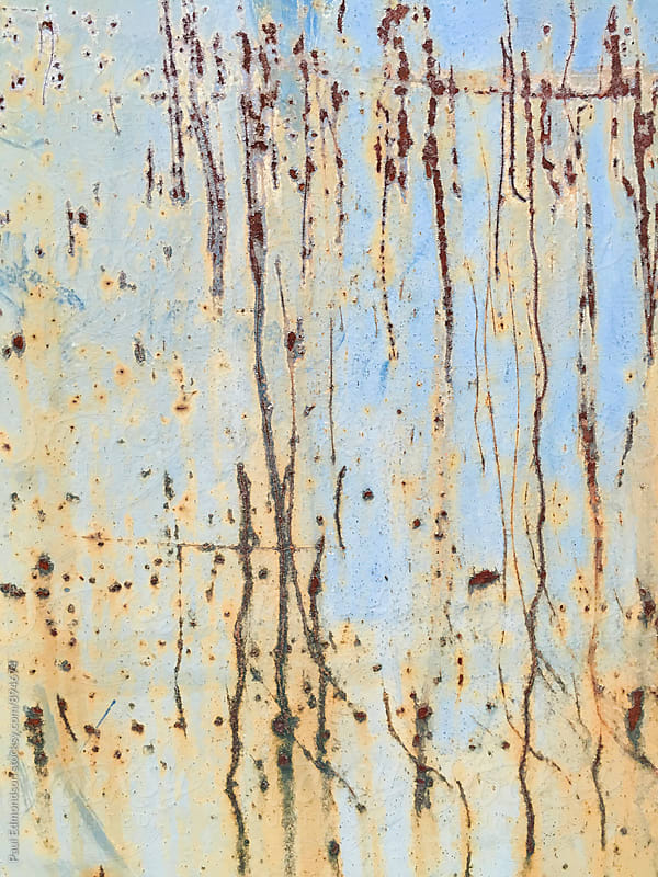 Detail of rusty metal trash can with scratch marks  by Paul Edmondson for Stocksy United