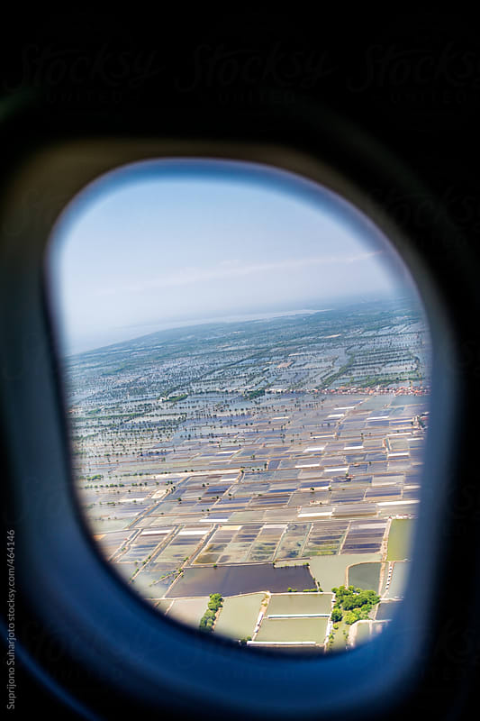 View of the beautiful scenery from inside of a flying airplane by Suprijono Suharjoto for Stocksy United