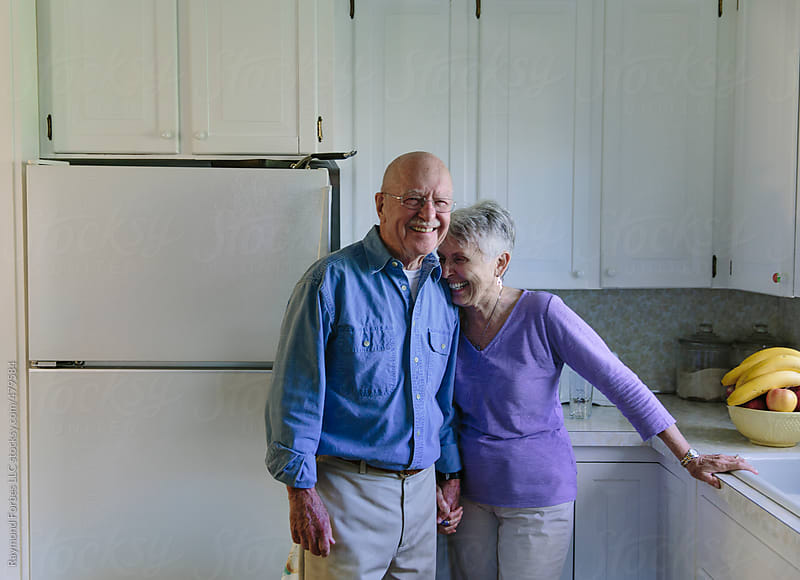 Senior Couple at HOme by Raymond Forbes LLC for Stocksy United