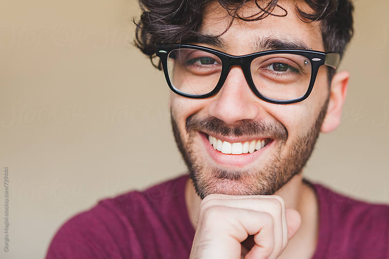 Closeup Portrait of a Young College Student with Glasses by Giorgio Magini for Stocksy United