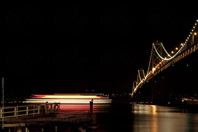 Moving ship lit up at night by Anna-Marie Panlilio for Stocksy United