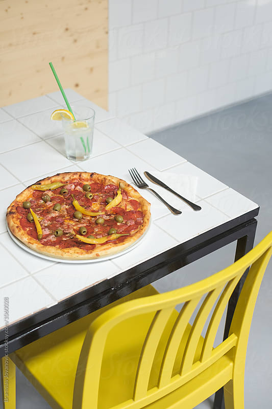 Delicious Pepperoni Pizza on the Table by Branislav Jovanović for Stocksy United