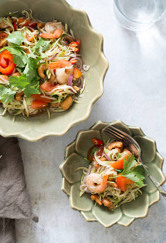 Thai mango salad with fresh shrimps and cashew nuts by Alita Ong for Stocksy United