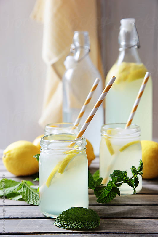 Chilled glasses of lemonade with mint by Sandra Cunningham for Stocksy United
