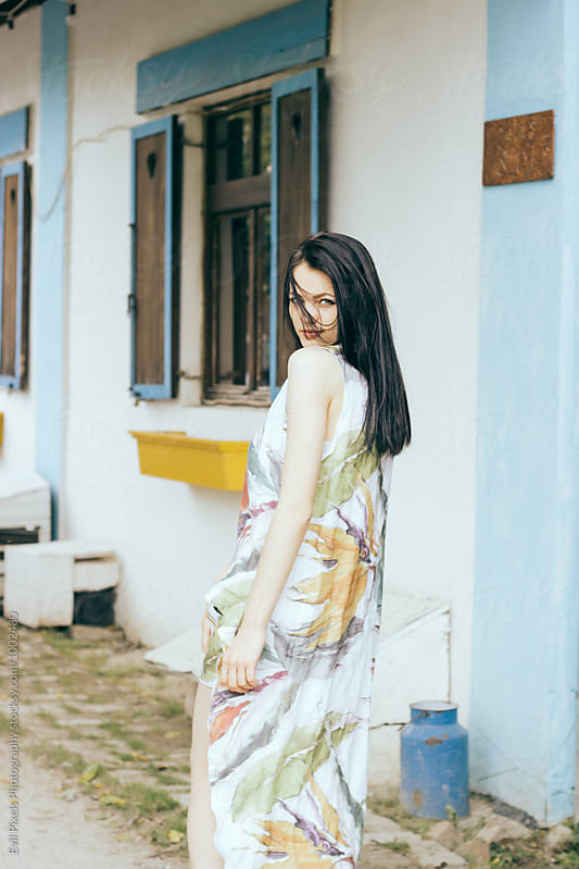 Beautiful female model walking in the village  by Evil Pixels Photography for Stocksy United