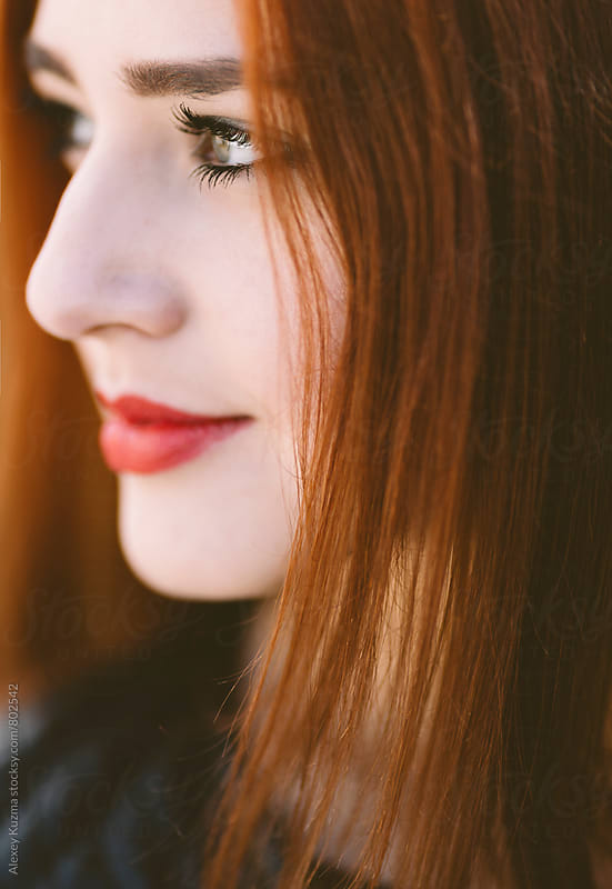 young woman with red hair in closeup by Vesna for Stocksy United