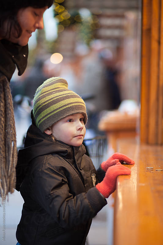 Mother and son on Christmas market by Mima Foto for Stocksy United