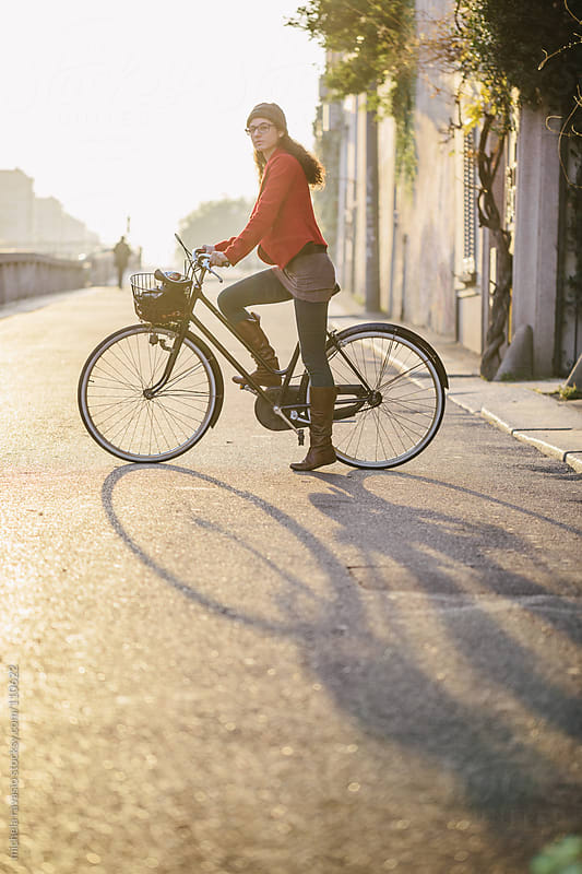 Young woman with her bicycle by michela ravasio for Stocksy United