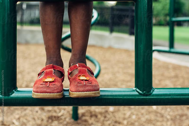 African American girl's feet at a playground by Gabriel (Gabi) Bucataru for Stocksy United