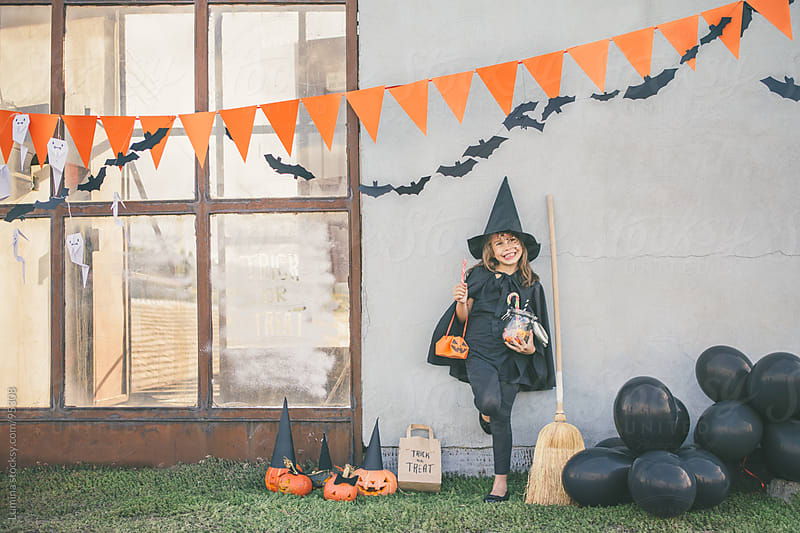 Witch Ready for Trick-or-Treating by Lumina for Stocksy United