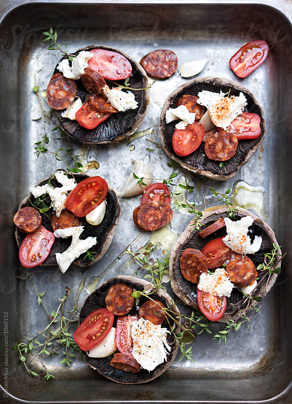 Preparing stuffed portobello mushrooms. by Darren Muir for Stocksy United