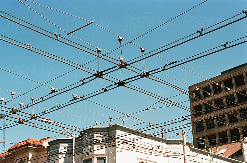 Crossing Cables in front of Buildings in San Francisco by Briana Morrison for Stocksy United