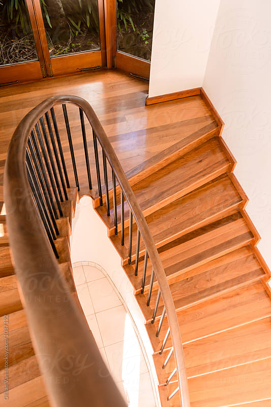 looking down at a timber staircase in a modern home by Gillian Vann for Stocksy United