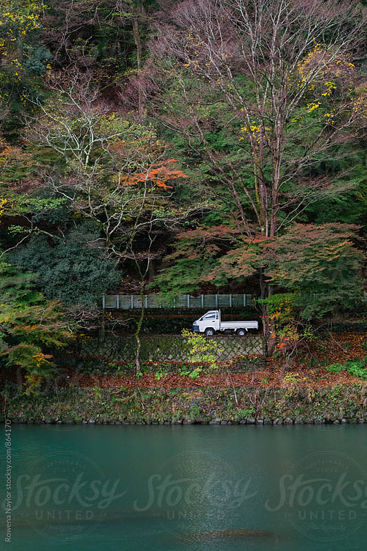 Small white truck amongst glorious autumn color in Kyoto, Japan by Rowena Naylor for Stocksy United
