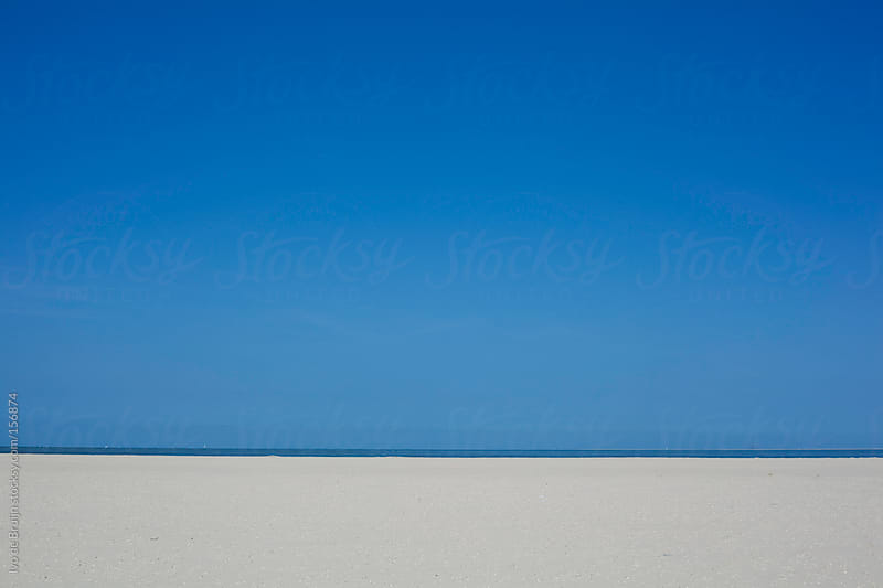 A photo of an empty beach, sky and sea by Ivo de Bruijn for Stocksy United