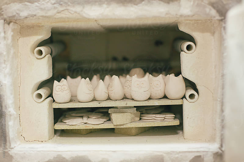 Ceramic owls in the oven by Nabi Tang for Stocksy United
