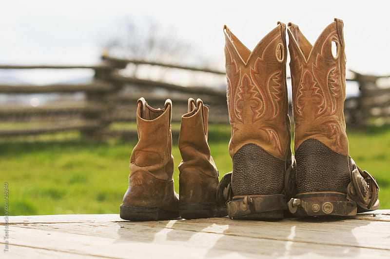 Father and son cowboy boots. by Tana Teel for Stocksy United