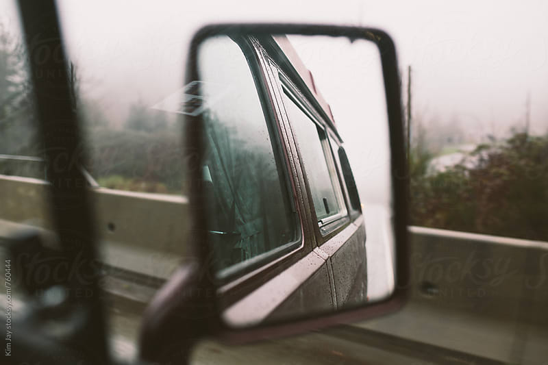 Highway driving reflection by Kim Jay for Stocksy United