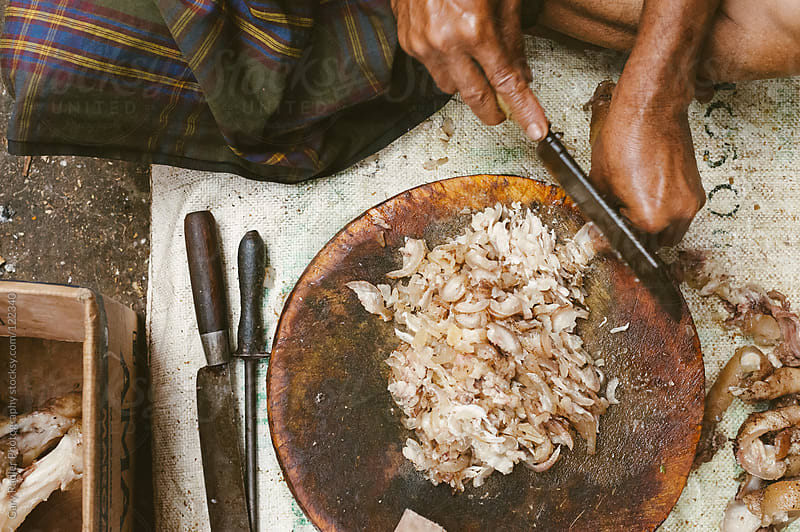 Balinese Man Finely Chopping Cooked Pork by Gary Radler Photography for Stocksy United