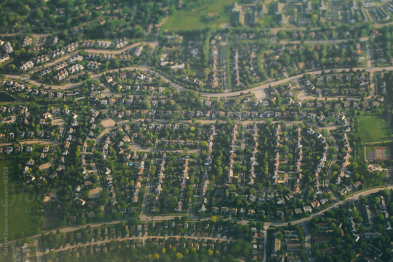 Bird's-eye view of a Chicago-area suburb, taken from an airplane by Kathryn Swayze for Stocksy United