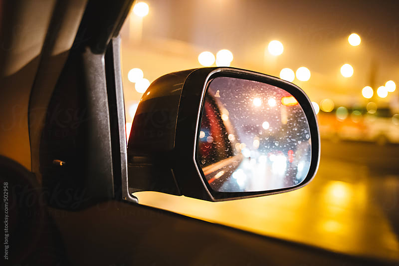 Rearview mirror in the night by zheng long for Stocksy United