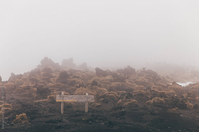 Warning label in a fog by Andrey Pavlov for Stocksy United