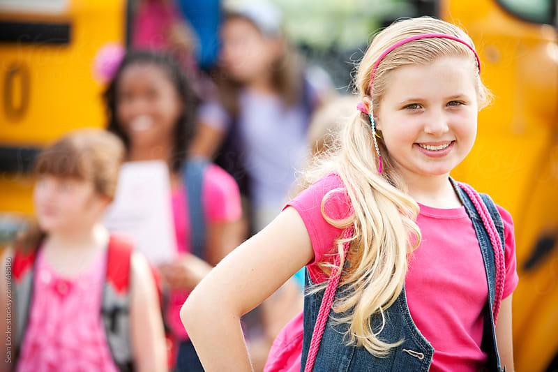 School Bus: Cute Girl Arrives Home by Sean Locke for Stocksy United