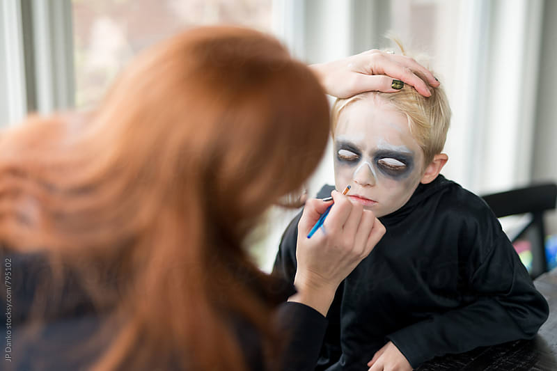Mother Applying Little Boys Scary Halloween Costume Make Up by JP Danko for Stocksy United