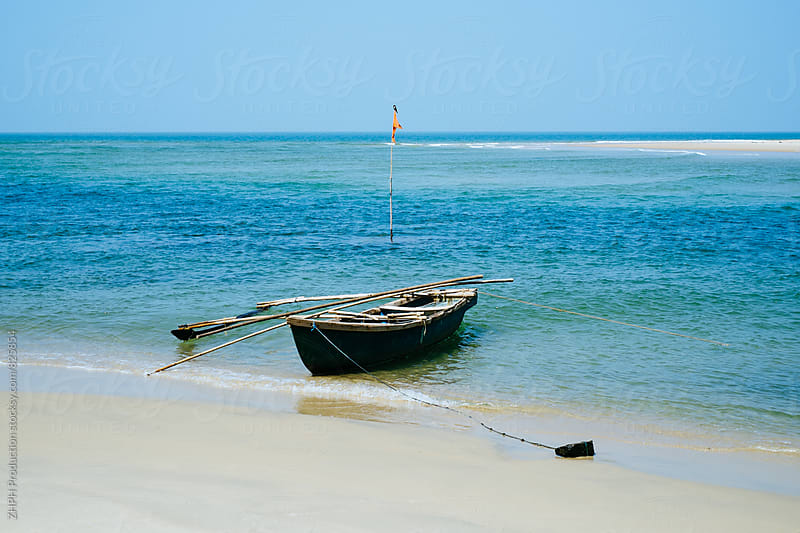 Old boat on the beach by ZHPH Production for Stocksy United