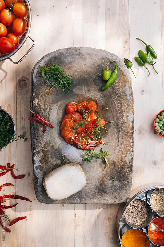 Ingredients to make Tomato-Coriander Aachar  by Shikhar Bhattarai for Stocksy United