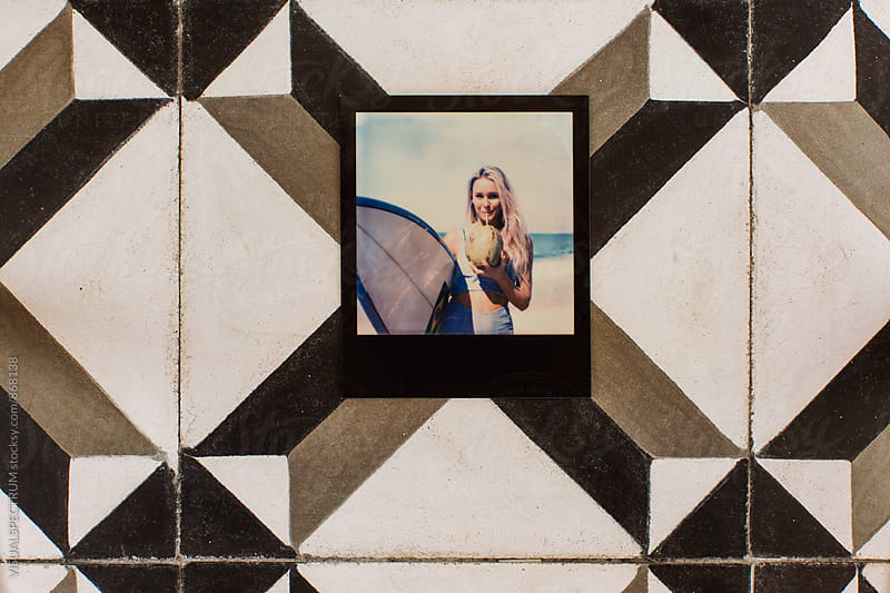 Polaroid of Young Blond Surfer Woman Drinking Fresh Coconut on Vintage Tiles by Julien L. Balmer for Stocksy United