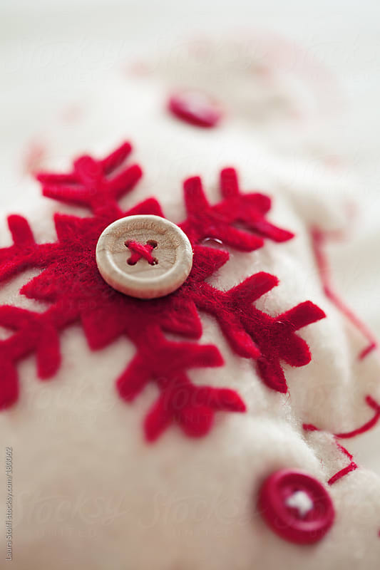 Detail of felt tree shaped Christmas ornament by Laura Stolfi for Stocksy United