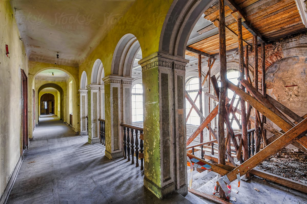 Old Abandoned Staircase With Pillar And Arch By Christian Richter For  Stocksy United
