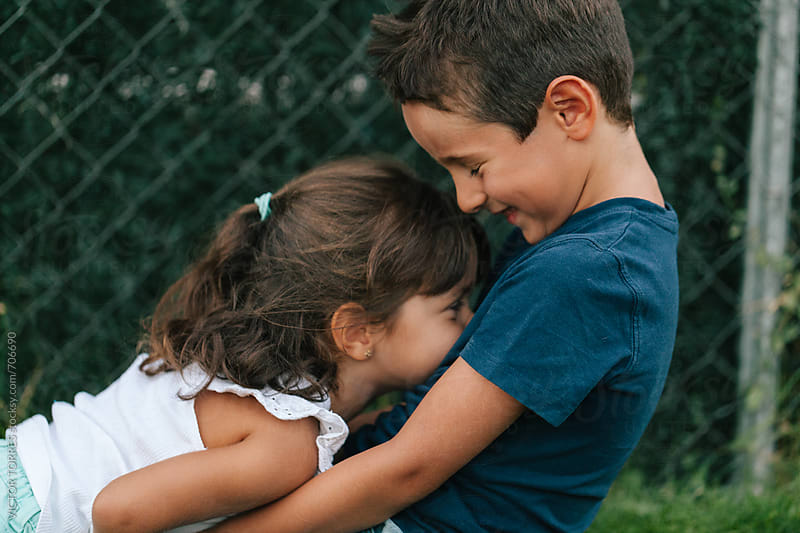 Brother and Sister Having Fun at the Park by Victor Torres for Stocksy United