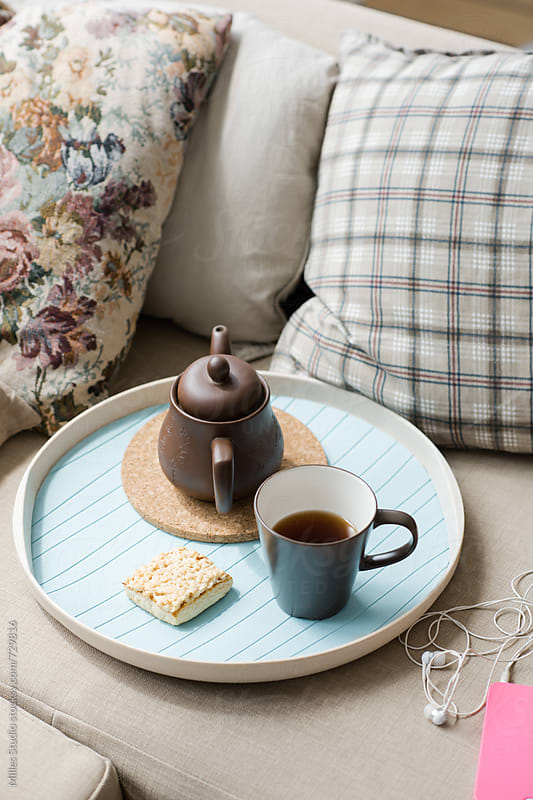 Tea set on couch by Milles Studio for Stocksy United