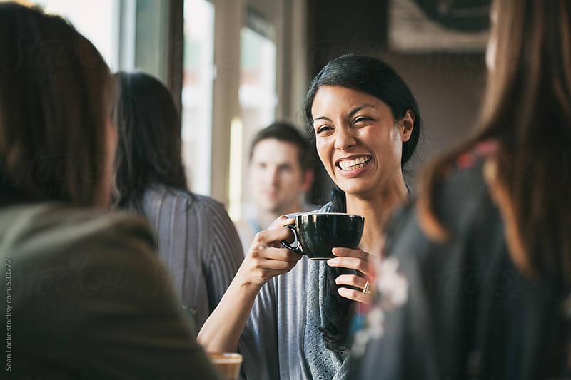 Cafe: Friends Having Fun Conversation by Sean Locke for Stocksy United