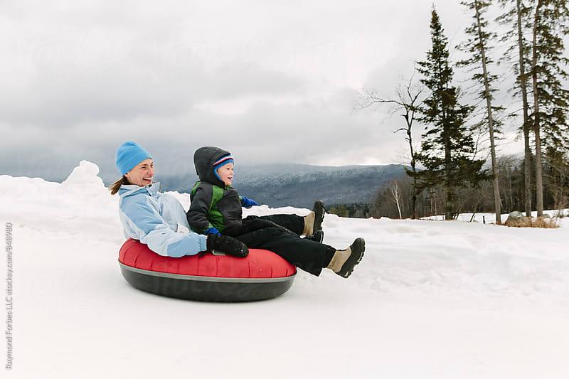 Winter Tubing Fun by Raymond Forbes LLC for Stocksy United
