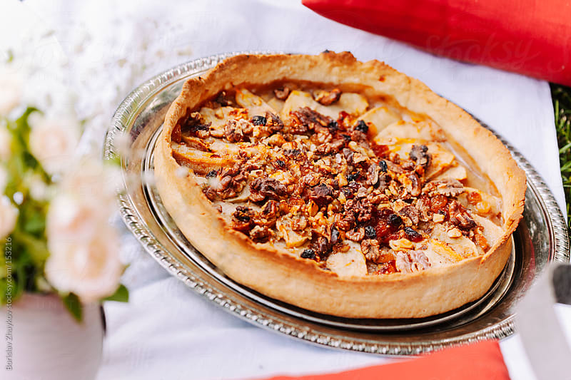 Apple pie with walnuts on top by Borislav Zhuykov for Stocksy United