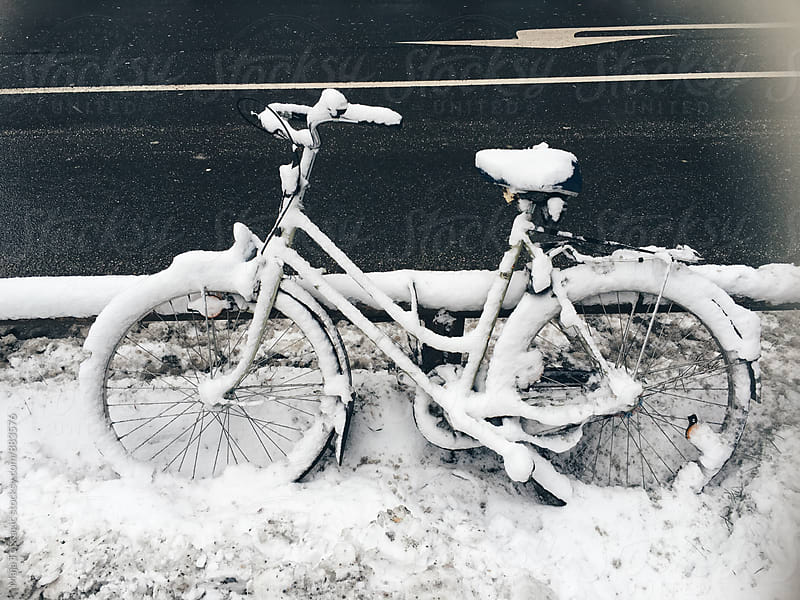 Bike covered with snow by Maja Topcagic for Stocksy United