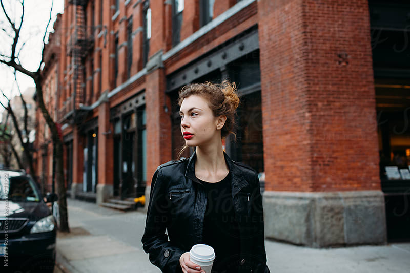 Stylish woman walking down the street by michela ravasio for Stocksy United