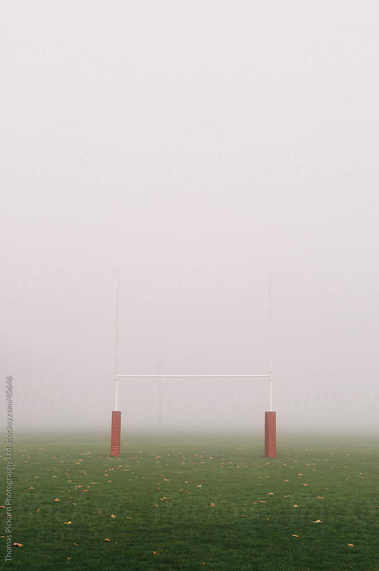 Football goal posts and early morning fog, Christchurch New Zealand by Thomas Pickard Photography Ltd. for Stocksy United
