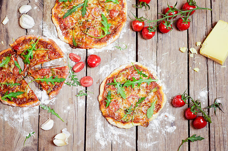 pizzas with ingredients by Canan Czemmel for Stocksy United