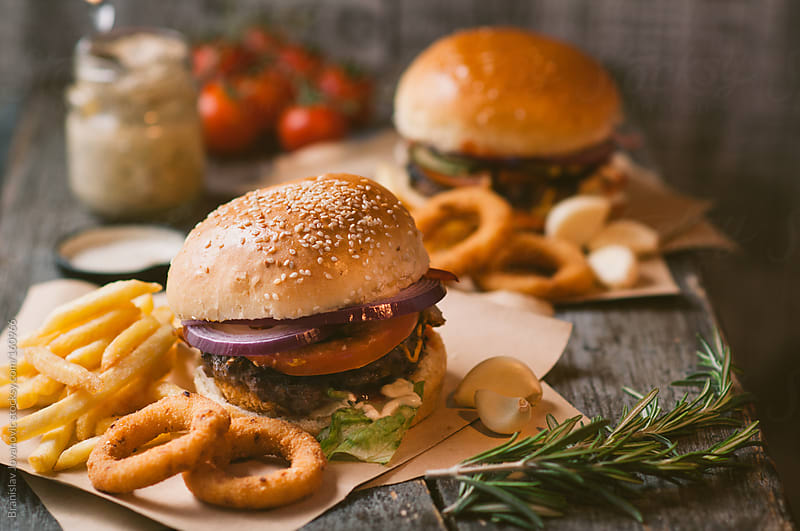Beef burgers with fries by Brkati Krokodil for Stocksy United