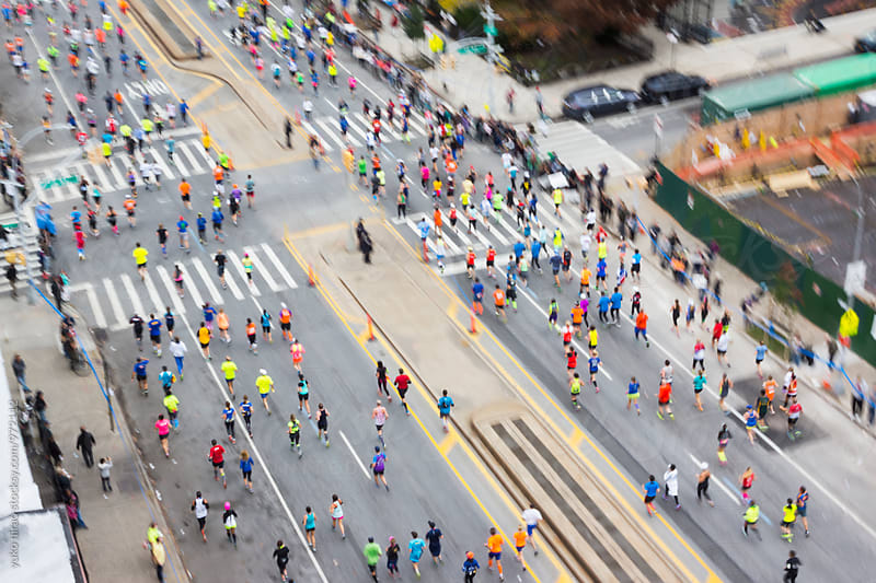 City marathon runners from above by yuko hirao for Stocksy United