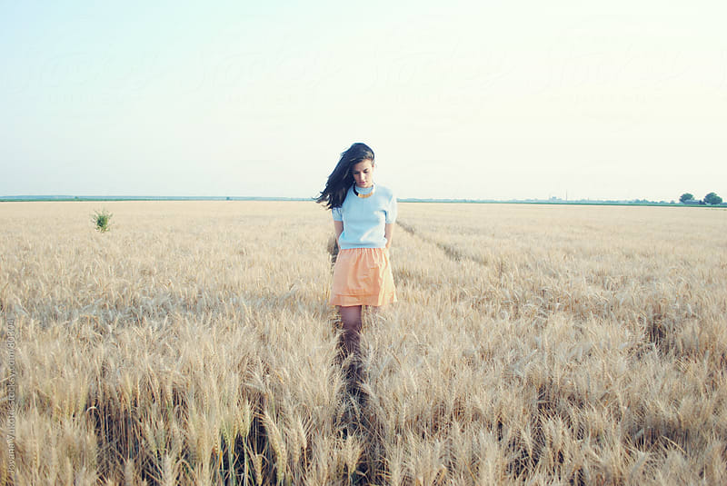 girl at the field by Jovana Vukotic for Stocksy United