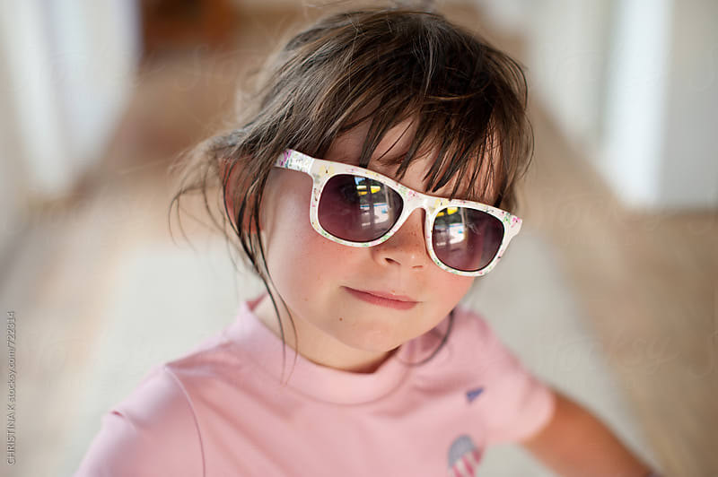 Little girl in flowery sunglasses by CHRISTINA K for Stocksy United