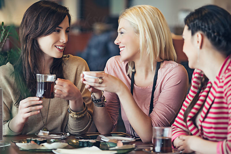 Smiling Women at a Restaurant by Lumina for Stocksy United