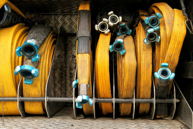 Fire hoses by Bisual Studio for Stocksy United